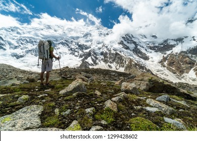Young hiker enjoying view of Nanga Parbat peak in Karakoram Mountain Range in Pakistan, one of the beautiful eight-thousanders.