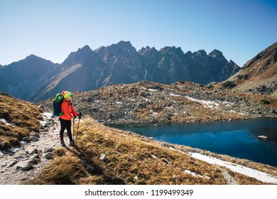 Young hiker in fantastic mountain landscape at winter near Zabie Pleso lake in High tatras
