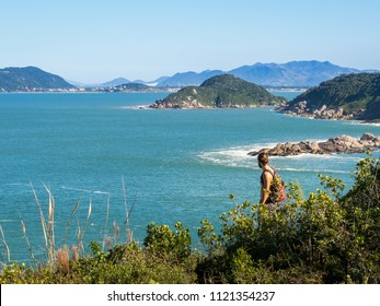 Young hiker in the Florianopolis archipelago, in Brazil.