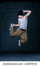 Young hip-hop dancer jumping