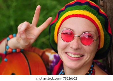 Young hippie woman making peace sign