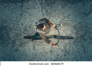 Young Hipster Cyclist Riding On Bike Down The Street, Top View. Daily Lifestyle Urban Resting Concept