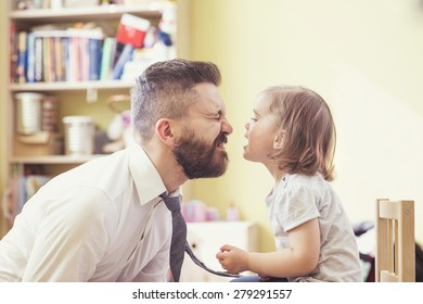 Young hipster father with his beautiful little daughter