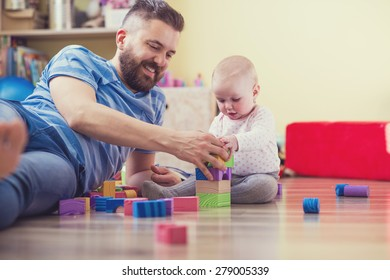 Young hipster father playing with his daughter