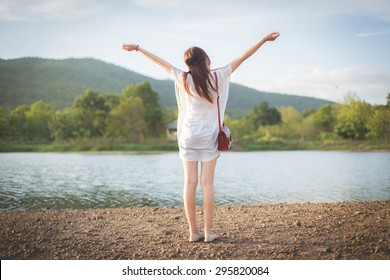 Young Hipster Girl Enjoying Near River, feeling refresh.