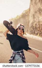 Young hipster girl posing with longboard, skateboard, street photo, life style, freedom, happy face,Beautiful young girl with tattoos riding longboard in sunny weather,Bali,cap,glasses, sneakers, road