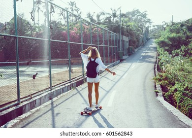 Young hipster girl posing with longboard, skateboard, street photo, life style, freedom, happy face,Beautiful young girl with tattoos riding longboard in sunny weather