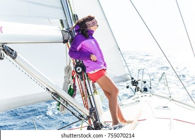 Young hipster girl in sunglasses on the yacht.woman in casual sport wear,stylish model,woman on yacht,girl on sea,fashion clothes,sports wear,sneakers,girl in summer holidays,tan,attractive,resting