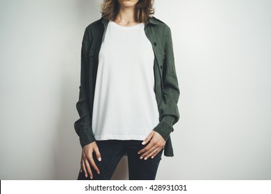 Young hipster girl wearing blank white t-shirt and green shirt, mock-up of white t-shirt in the white background