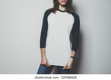 Young hipster girl wearing blank white t-shirt with green long sleeve, mock-up of t-shirt long sleeve
