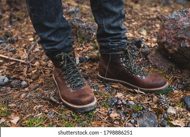 young hipster man, hiking in wild nature, winter vacation, traveling, warm shoes, boots close up, details feet, legs