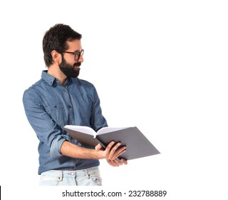 Young hipster man showing book over white background