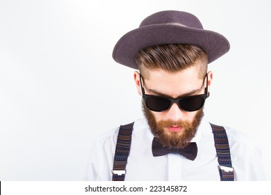 young hipster man wearing  hat and bow-tie