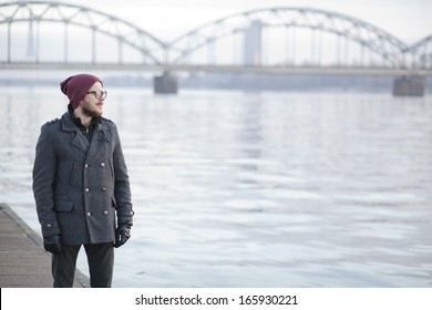 Young hipster with moustache and beard in Riga
