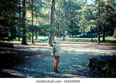 young hipster rabbit mask woman in the woodland autumn
