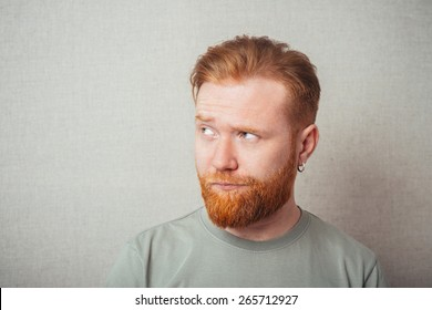 Young hipster red bearded Man Looking Impared