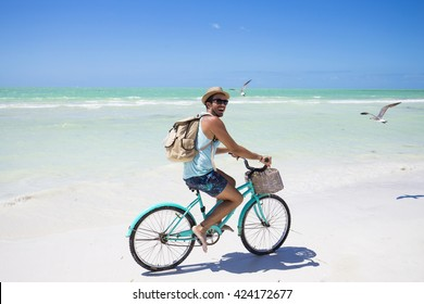 Young hipster using his smart phone on holidays in Mexico.