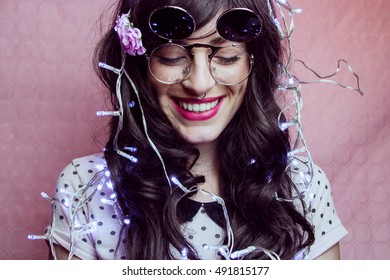 Young hipster woman smiling in a christmas party
