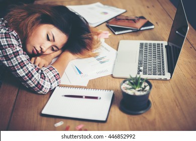 Young hipster woman tired for work and nap on workplace .