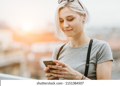 Young hipster woman using mobile phone