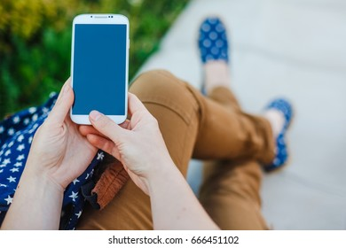 young hipster woman using smart phone outdoor