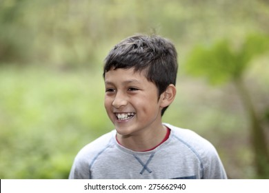 Young Hispanic boy playing in the woods - shallow depth of field
