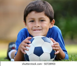 Young hispanic boy with soccer ball
