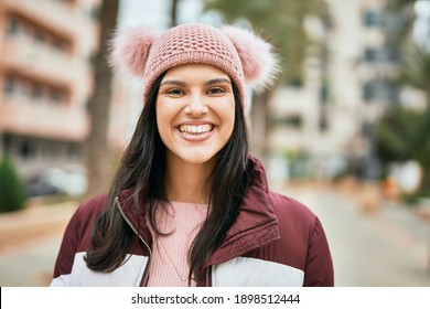 Young hispanic girl smiling happy standing at the city.