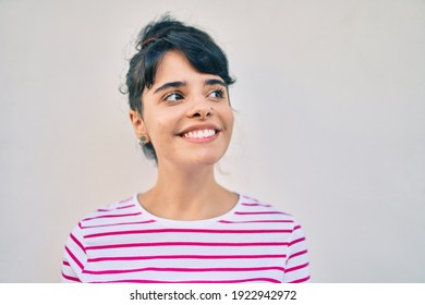 Young hispanic girl smiling happy walking at the city.