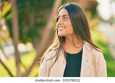Young hispanic girl smiling happy standing at the park.