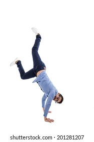 young hispanic man with blue shirt and glasses doing a cartwheel isolated over white