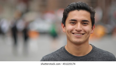 Young Hispanic man in city face portrait