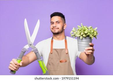young hispanic man happy expression. farmer or gardener concept