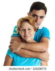 Young hispanic man hugging his mother isolated on white
