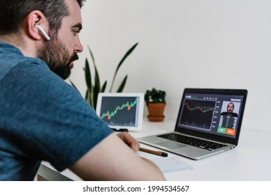 Young hispanic man learning to trade the stock market online. Hispanic student doing a video call with profesional trader to learn investing. Investment and financial concept
