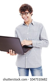 Young hispanic man wearing blue checkered shirt and black glasses reading something funny from his laptop and laughing isolated on white background - communication and internet humor concept