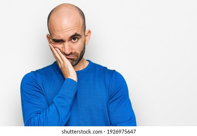 Young hispanic man wearing casual clothes thinking looking tired and bored with depression problems with crossed arms.