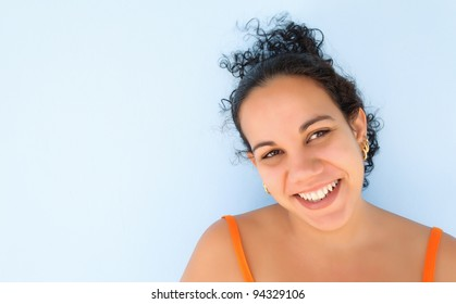 Young hispanic woman with a beautiful smile