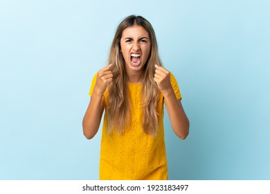 Young hispanic woman over isolated blue background frustrated by a bad situation