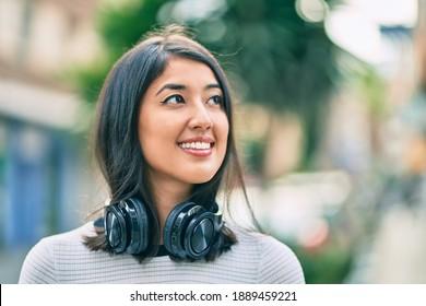 Young hispanic woman smiling happy walking at the city.