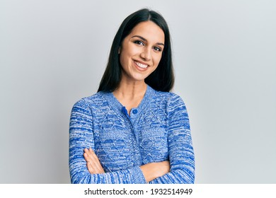 Young hispanic woman wearing casual clothes happy face smiling with crossed arms looking at the camera. positive person.