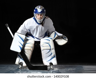 Young hockey goaltender in a ready position.