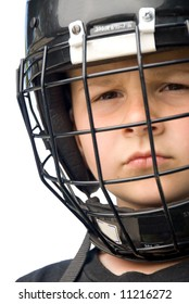A young hockey player with is face protected helmut glares a tough attitude into the camera.