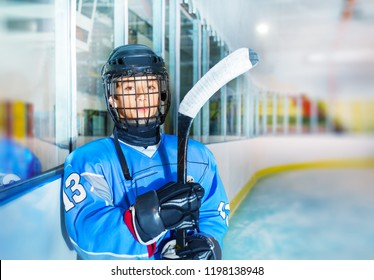 Young hockey player in protective equipment