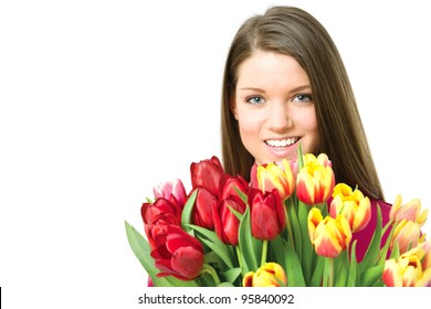 Young Holland woman portrait against white background with tulips bouquet and smiling at camera