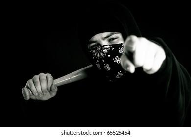 Young hooligan on dark background