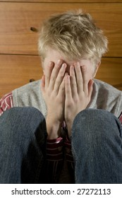 young hopeless blond man close eyes by hand