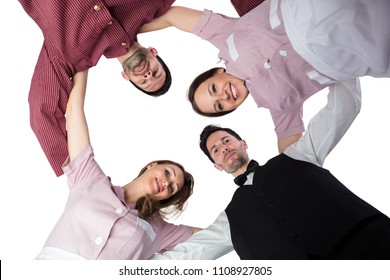 Young Hotel Staff Forming Huddle On White Background