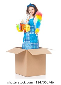 Young housewife with cleaning supplies in cardboard box, isolated on white background