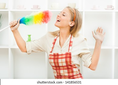 Young housewife enjoys in cleaning,Cheerful housewife
